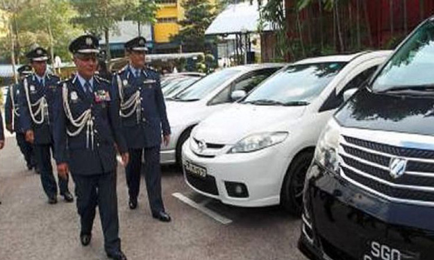 Singaporean housewife detained over smuggling of used luxury cars in Johor