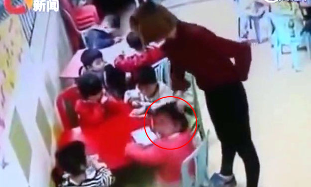 China kindergarten teacher caught abusing kids -- but watch what angry granny does to her