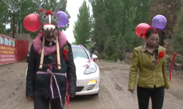China groom's parents dress as donkeys and pull Porsche with bride inside in shocking wedding prank