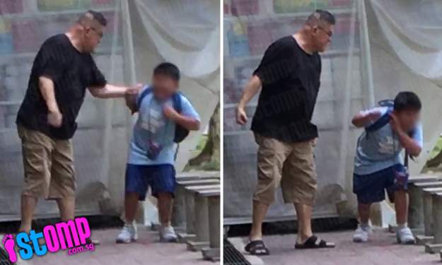 Man shouts and punches kid in public at Toa Payoh -- who cries as he tries to shield himself