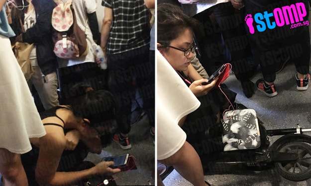 MRT commuters have to make way during morning rush hour -- for girl and her precious scooter