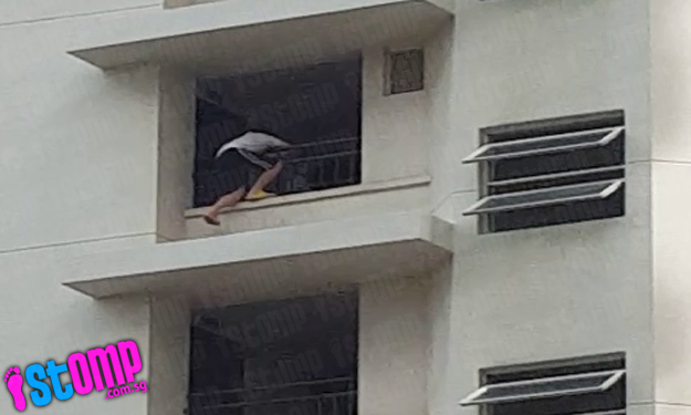 Does this kid on parapet of Hougang block even realise how dangerous his actions are?