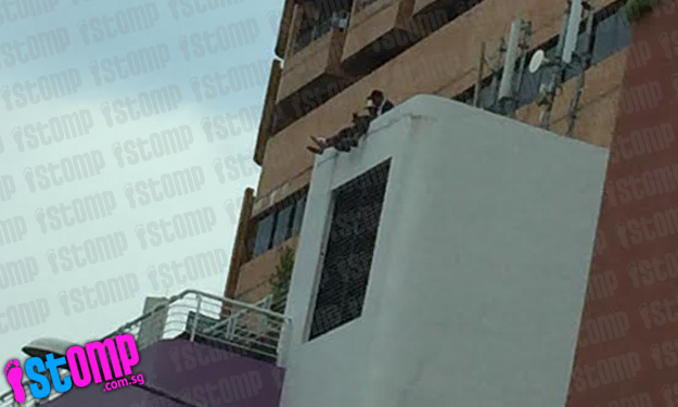 No better place to chill? Youths endanger their own lives by sitting on 7th floor ledge of Novotel