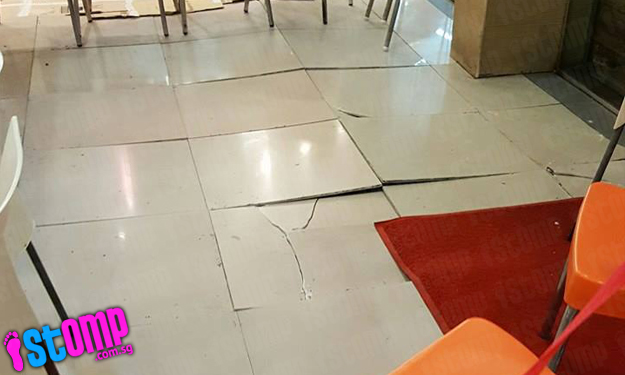 Another case of cracked tiles 'popping out' of ground -- this time at Woodlands food court