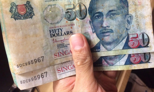 Heard of the fake $50 scare in Hougang? Here's how to differentiate real and fake notes