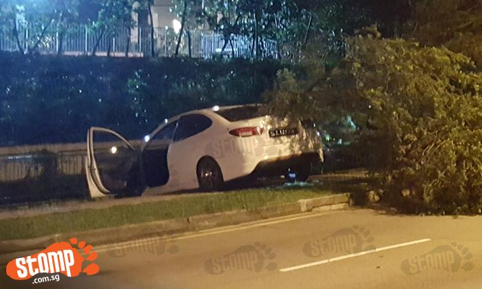Car mounts kerb and crashes into tree at Boon Lay Way