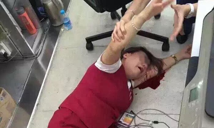 Angry passenger assaults Shenzhen airport clerk and leaves her lying in pool of blood