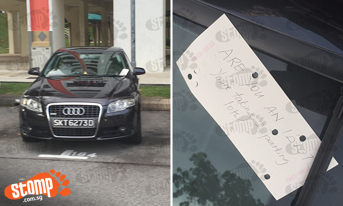 Driver approaches car parked on two lots in Jln Bukit Merah carpark, then sees this note on its windscreen