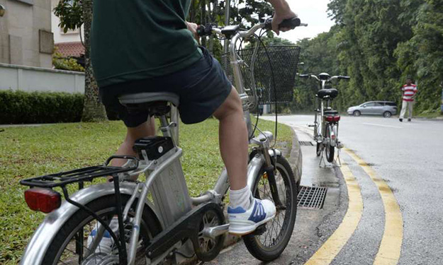 E-biker dies in crash with lorry on Pioneer Rd: More road safety awareness needed