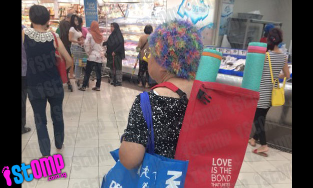 Auntie with 'happening' hairstyle catches shoppers' eyes at Nex