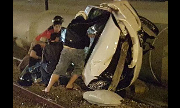 Singapore car badly wrecked after accident on tracks towards Woodlands Train Checkpoint
