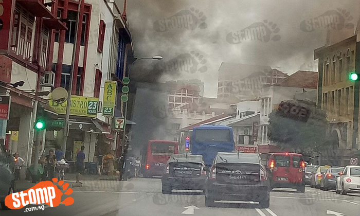 Thick plume of smoke seen from shophouse in Geylang Rd