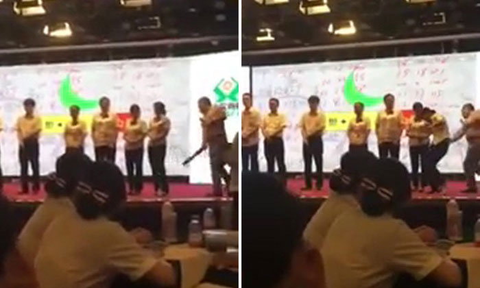 Chinese bank manager publicly shames and spanks employees on stage with ruler for underperforming