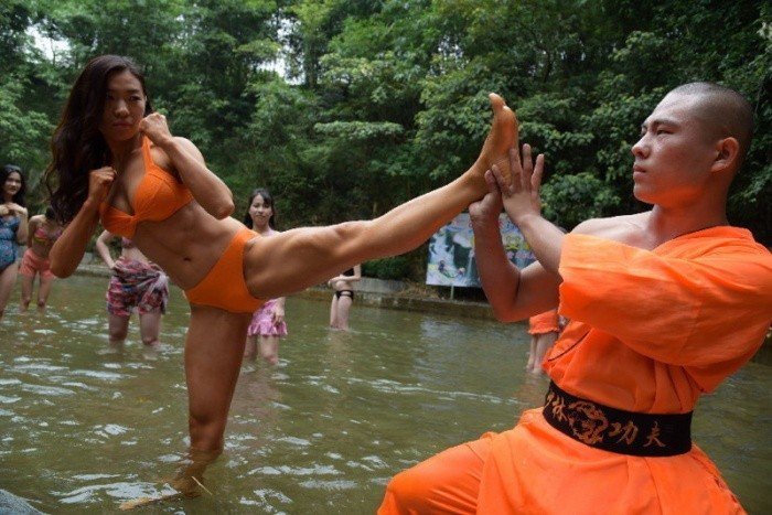 'Bikini lifeguards' at China rafting attraction train with Shaolin monks