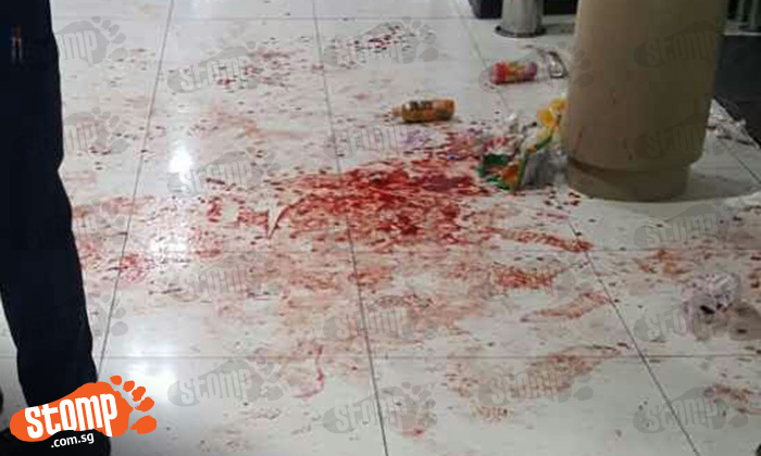 Floor covered in blood after fight at Orchard Plaza