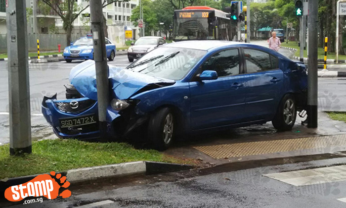 Car crashes into traffic light at Yishun Ave 11 junction after getting hit by taxi