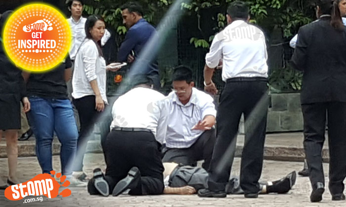 Two men perform CPR on middle-aged man who collapsed at Millenia Walk