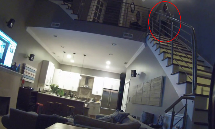 So eerie! 'Creeper Ghost' watches over sleeping couple in Chicago -- literally