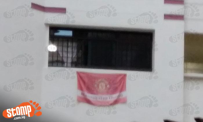 How Man U fan celebrates National Day