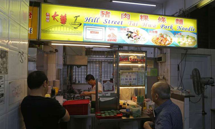 Hawker stalls selling bak chor mee and chicken rice awarded with Michelin stars