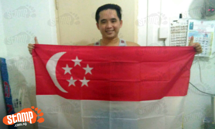 I might be 'Johorean' -- but I'm so proud to hold this great flag and celebrate National Day!