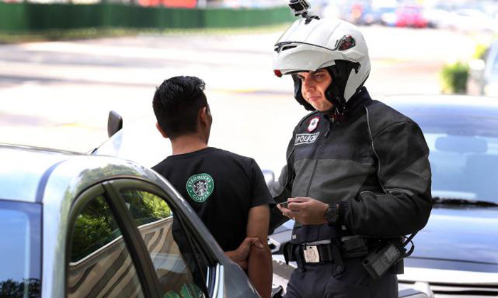 'Men in black bikers' stop errant motorists -- and catch them by surprise