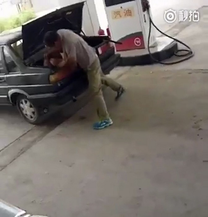 Woman gets beaten and stuffed in car boot by man in China, while people look on