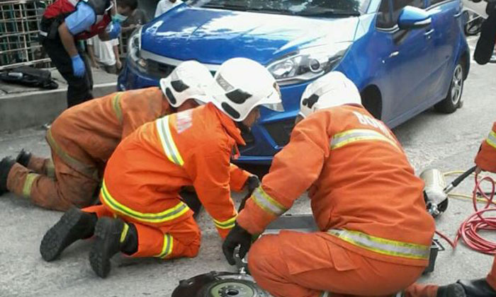 Woman run over by own car in Malaysia after she tried to stop it from rolling backwards