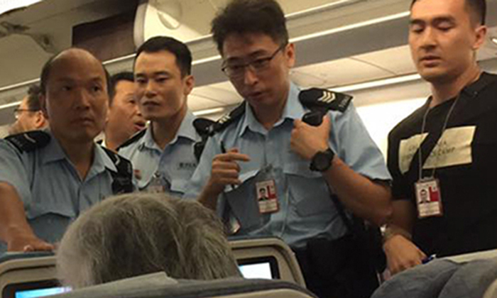 Chinese passenger arrested for throwing juice on Cathay Pacific flight attendant during argument