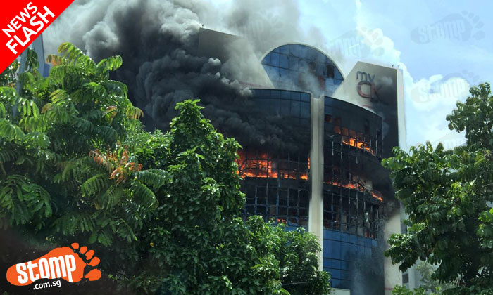 BREAKING NEWS: Huge fire engulfs several levels of CK building in Tampines