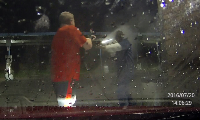Armed thieves try to steal vehicle during car wash -- only to get owned big time by owner's hose