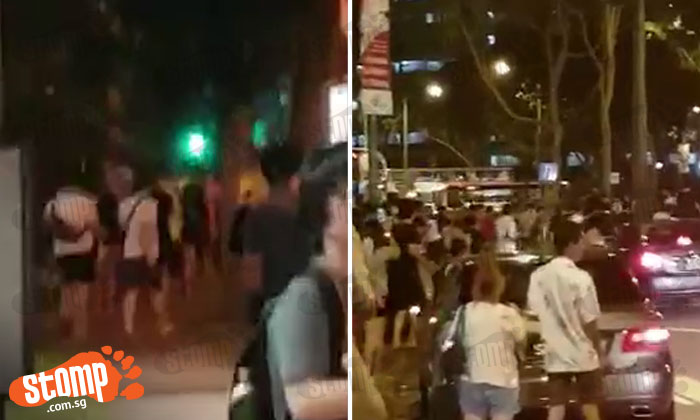 Seriously guys, the game is not worth your life! 'Crazy' crowd near Block 401 in Hougang rushes across road to catch Pokemon