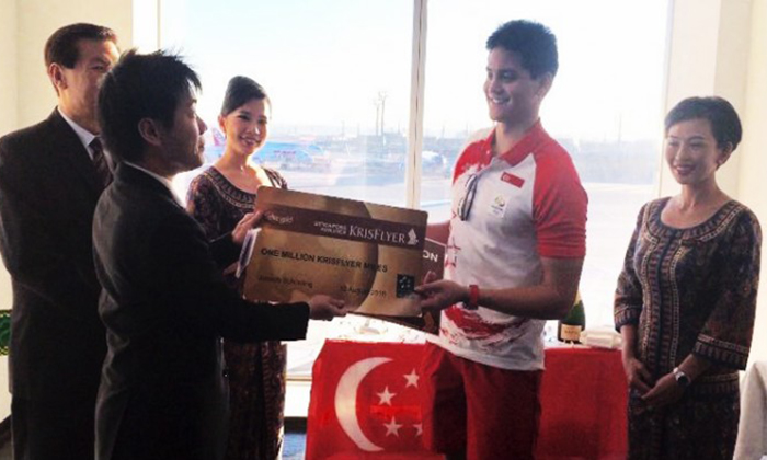 Singapore Airlines presents 1 million KrisFlyer Miles to 'King of Butterfly' Joseph Schooling