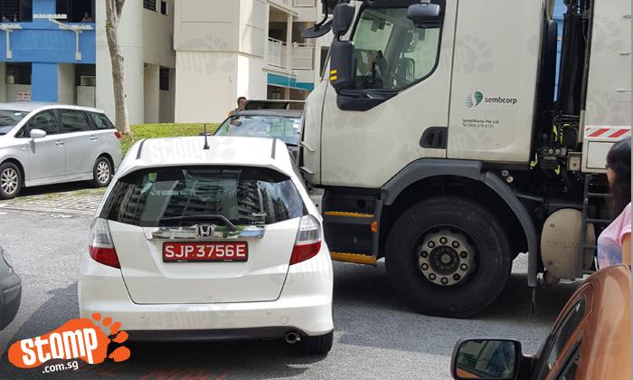 Loud bang heard after lorry gives car a 'smooch' at Hougang carpark
