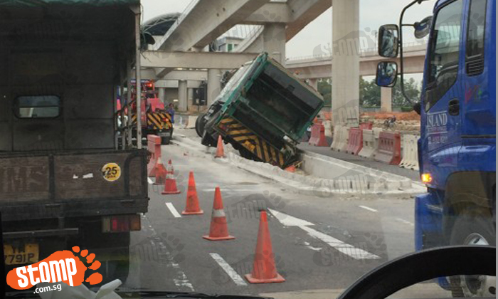 Truck ends up in a pit at Tuas West Drive