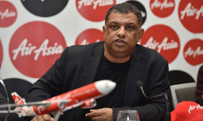 AirAsia boss apologises to stewardess after she's forced to 'kow tow' to passenger