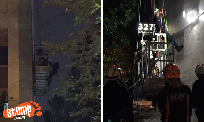 Late night drama as workers get stuck in gondola at Block 327 Jurong East