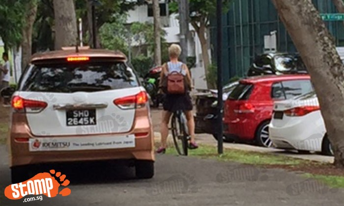 Taxi drove on pedestrian pathway, almost knocking cyclist over