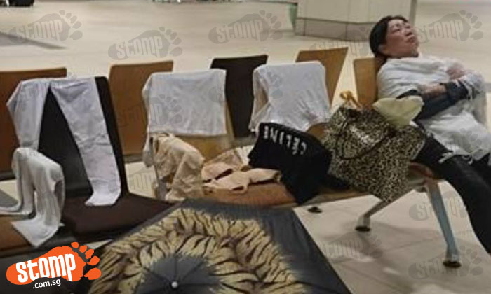 Woman airs her dirty laundry at Changi Airport Terminal 1 -- literally