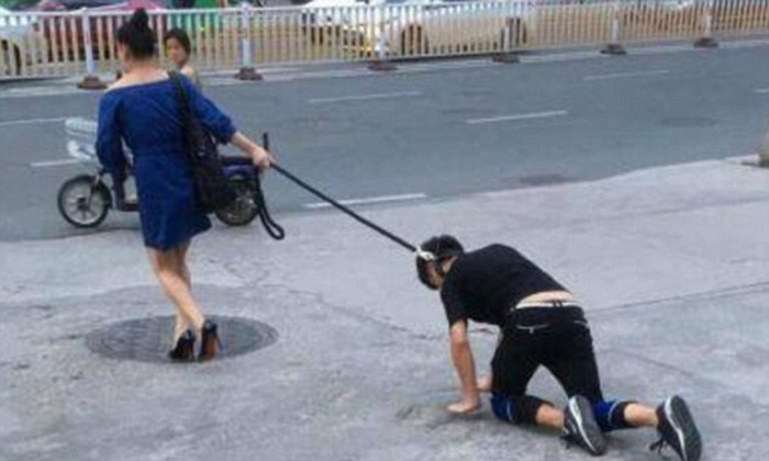Woman in China 'walks' man on leash like a dog