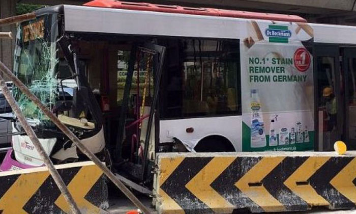 2 passengers suffer bruises and cuts after bus crashes into road divider at Clementi