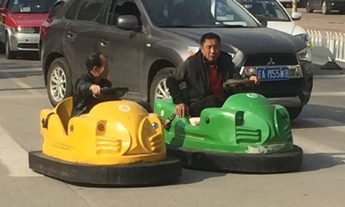 Are they for real? 2 uncles take bumper cars for joyride on road in China