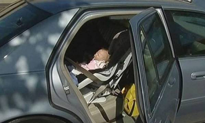 US cop breaks into car to rescue baby trapped inside -- only to discover heartbreaking truth