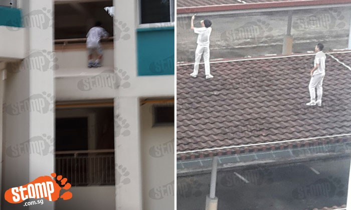 What are they thinking? One boy hangs on 2nd-story ledge, another 2 take selfie on walkway roof
