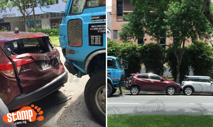Lorry driver sent to hospital after 4-vehicle accident along Kaki Bukit Road 1
