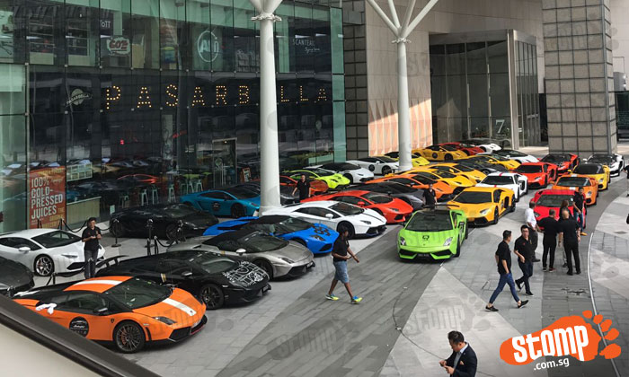 Fleet of Lamborghinis show up at Suntec City to give rides to kids for Punggol Town CC building fund