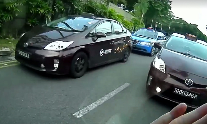 Thank you gracious SMRT taxi drivers, for giving way to driver in city traffic