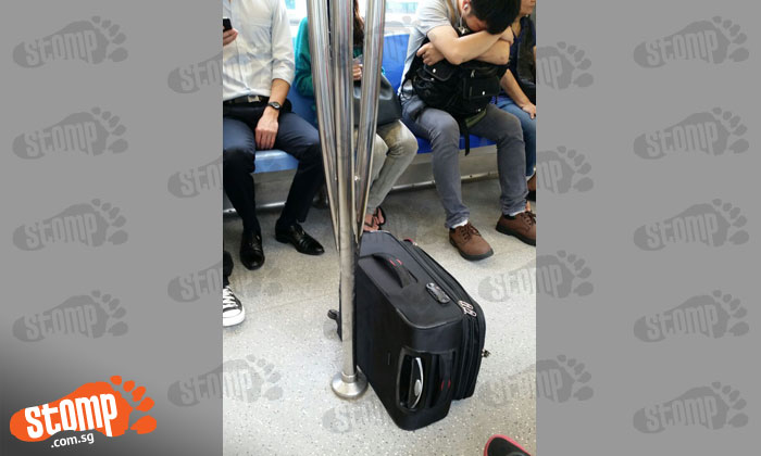 Guy leaves luggage lying right smack in middle of MRT carriage