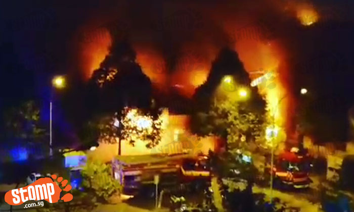 Huge fire lights up sky as flames engulf coffee shop and wet market at Blk 493 Jurong West St 41