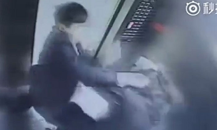 Man violently attacks woman who asks him not to smoke in lift -- right in front of her kid